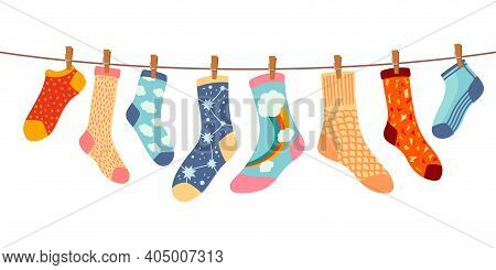 Socks On Rope. Cotton Or Wool Sock Dry And Hang On Laundry String With Clothespins. Children Socks W