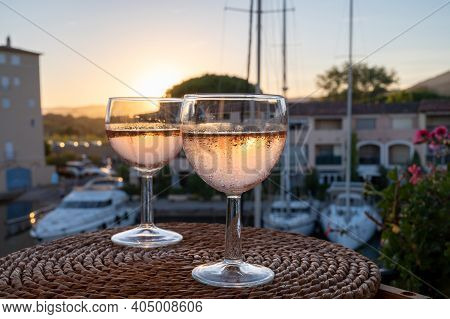 Tasting Of Local Cold Rose Wine In Summer With Sail Boats Haven Of Port Grimaud On Background, Prove