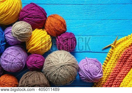 Hobbies And Knitting Concept.  Colorful Balls Of Wool And  Knitted Cloth With Knitting Needles On  B