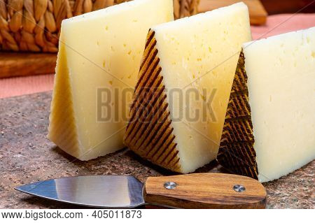 Cheese Collection, Pieces Of Hard Spanish Manchego Curado, Viejo And Iberico Cheeses Close Up