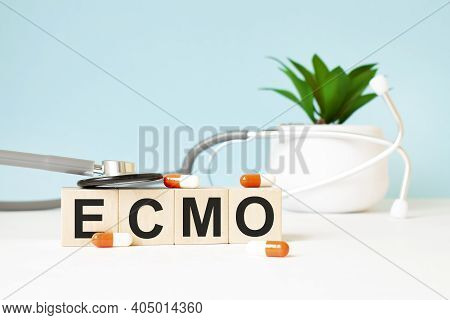 The Word Ptsd Is Written On Wooden Cubes Near A Stethoscope On A Wooden Background. Medical Concept