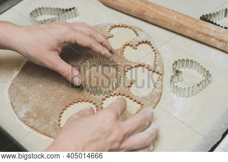 Process Of Cutting Cookies By Cookie Cutters. Woman Making By Hands Forms For Cookies From Raw Dough
