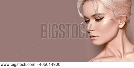 Beautiful Sexy Woman With Luxury Make-up. Girl With Blond Hair On Beige Background. Style For Womans