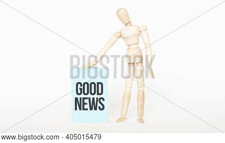 Good News Concept. Wooden Puppet Touch Green Wooden Block. Business Concept