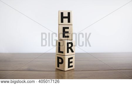 Help Is Here Symbol. Turned Cubes And Changed The Word Help To Here. Beautiful Wooden Table, White B