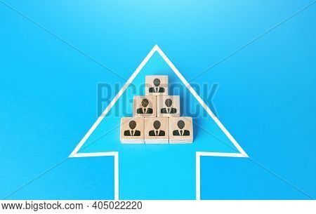 Blocks With People United In A Single Move Arrow. Consolidation For A Common Goal. Organization Coop