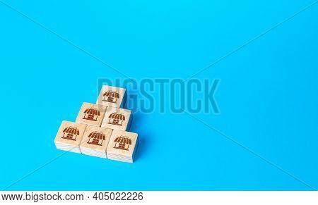 Block Pyramid With Shop Symbols. Franchising Concept. Business Franchise. Commercial Association. Bu