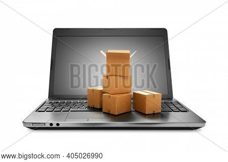 Online shopping concept, Carton Boxes placed on laptop, including clipping path