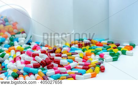 Pile Of Antibiotic Capsule Pills With Plastic Bottle. Antibiotic Drug Resistance. Antimicrobial Drug
