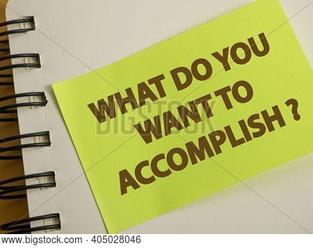 What Do You Want To Accomplish, Text Words Typography Written On Paper Against Wooden Background, Li