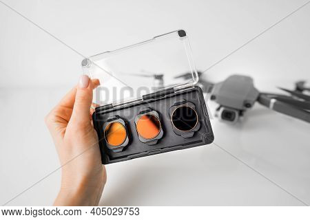 Woman Hand With Nd Filters And Polarising Filters Set For Drone. Filters For The Drone Camera.