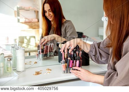 Young Woman Is Neatly Organizing Her Lipstick, Lip Gloss In The Makeup Storage At Home.