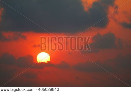 Beautiful Sunset Orange Yellow Red Silhouette Gray Sky In Back On Cloud