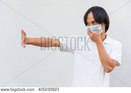 Asian Man Wear Hygienic Mask Show Acting Social Distancing Concept  For Avoid The Disease