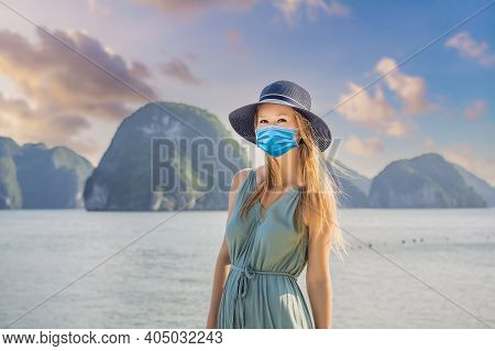 Attractive Woman In A Dress Wearing A Medical Mask During Covid-19 Coronavirus Is Traveling In Halon
