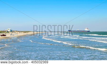 Afternoon Beach Scene At The Gulf Of Mexico With Sand, Waves, Cars, People Enjoying Themselves, And