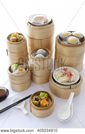Chinese Dimsum Bamboo Steamer. Many Dimsum In The Steam Basket On White Background.