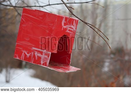 Red Bird Feeder With Cardboard Pasted Over With Transparent Film