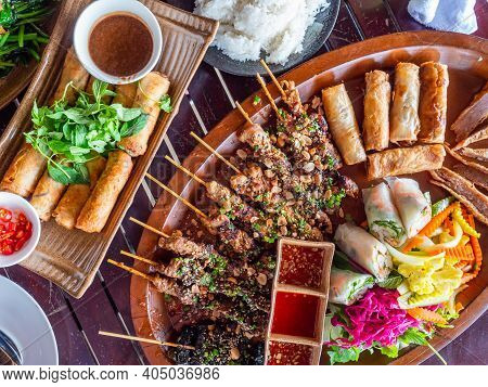 Vietnamese Wraps, Condiments And Barbecue Sticks At A Restaurant Table In Nha Trang.