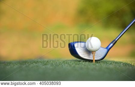 Golf Ball Club Hitting Golfing Along Fairway, Green Nature Background. Lifestyle And Healthy Concept