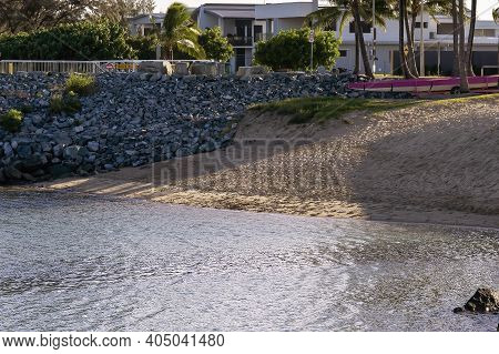 A Small Beach Beside A Marina Seawall And In Front Of The Oceanfront Residential Precinct In Late Af