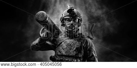 Portrait Of A Special Forces Soldier With An Assault Ram On His Shoulder. Swat Concept. Anti-terrori