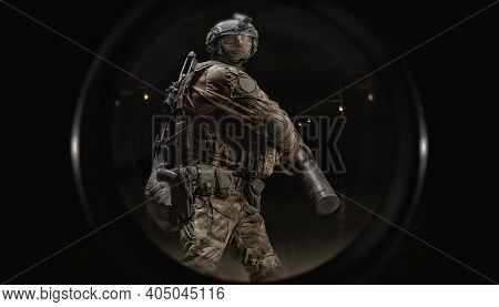Image From The Peephole Of The Apartment. A Soldier Of A Special Forces Group Knocks Out The Front D