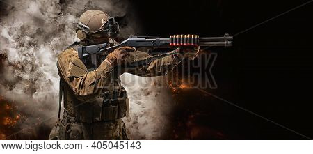 American Soldier Comes Out Of The Smoke On The Battlefield. The Concept Of Military Special Operatio