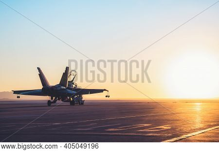 Jet Fighter On An Aircraft Carrier Deck Against Beautiful Sunset Sky . Elements Of This Image Furnis