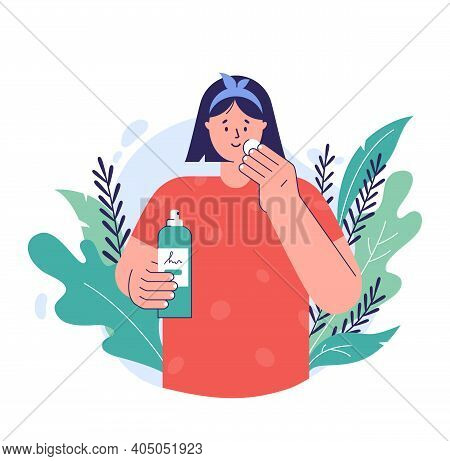 Skin Care Concept. A Young Woman Applying Tonic To Cotton Disc On Her Face. Natural Cosmetic Beauty