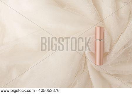 Lipstick On Creamy Lightweight, Transparent Tulle Fabric In Beautiful Folds. Cosmetic Metallic Shiny
