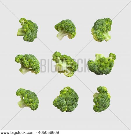 Fresh Raw Green Broccoli Isolated On Gray Background. Collection Of Broccoli In Different Shapes. He