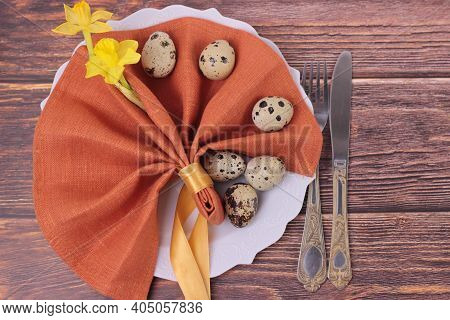 Beautiful Easter Holiday Table Setting With Cutlery On Barn Boards.narcissus, Quail Eggs, Eating Ute