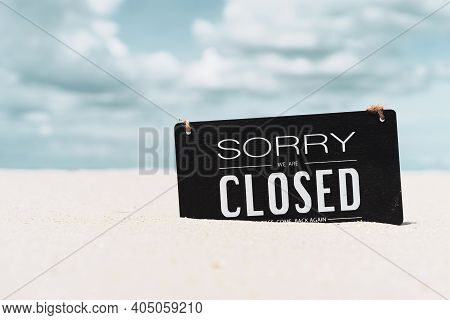Closed Sign On Tropical Sand Beach With Blue Sky Background. Summer Vacation And Travel Holiday Conc