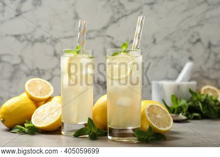 Natural Lemonade With Mint And Fresh Fruits On Light Grey Table. Summer Refreshing Drink