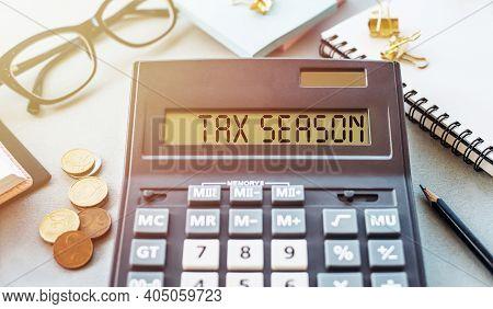 Word Tax Season Written On Calculator On Office Table.