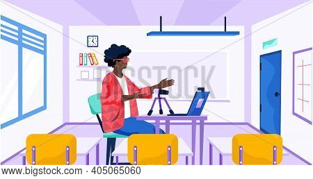 Girs With A Laptop Studies On Her Computer. A Woman In A Lesson At School Records Audio. A Lecturer