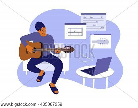 Young Man Sitting Home, Learning Playing Guitar. Online Video Course Of Play Musical Instrument. E-l