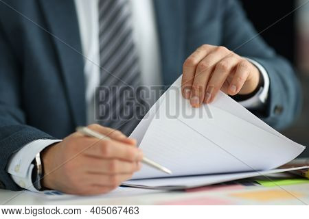 Businessman In Suit Holding Documents In His Hands In Office Closeup. Hr Management Concept