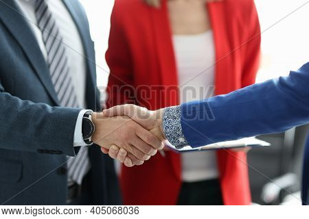 Business People Shaking Hands In Office Closeup. Business Partnerships Concept