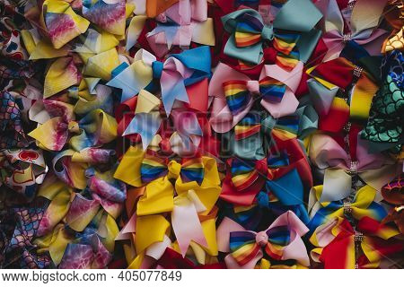 Quirky Pastel Colored Bright Colorful Bowties Hanging From A Wall At A Market.
