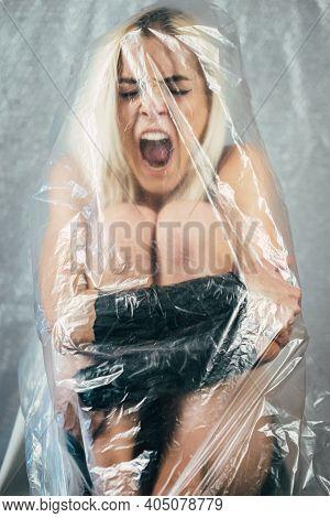 Desperate Woman. Defocused Conceptual Portrait. Domestic Violence. Bulling Depression. Screaming Hel