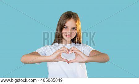 Love Sign. Romantic Message. Sympathy Appreciation. Portrait Of Friendly Positive Happy Teen Girl In