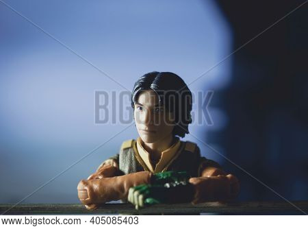 JAN 25 2021: Star Wars Rebels cartoon Ezra Bridger looks out over Lothal from his home tower - Hasbro action figure