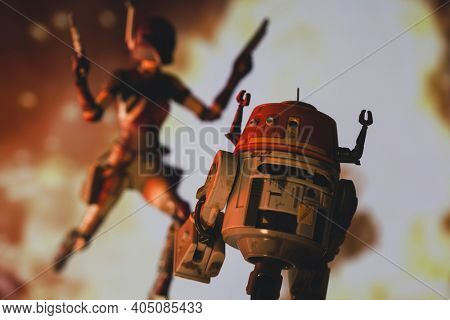 JAN 25 2021: Star Wars Rebels astromech C1-10P droid Chopper and Mandalorian Sabine Wren escaping an explosion  - Hasbro action figure