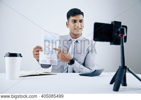 Cheerful Indian Financial Manager Talking In Front Of Smartphone Camera When Explaining Details In R