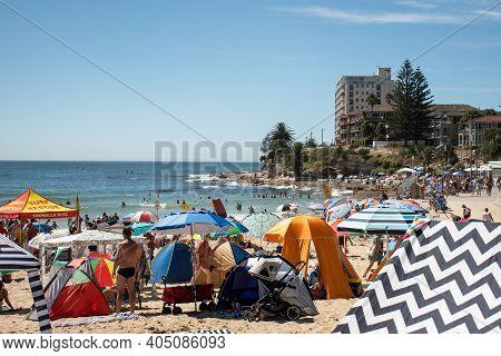 Sydney, Australia 2021-01-26 Extremely Overcrowded Cronulla Beach On Australia Day. Umbrellas On The