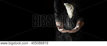Beautiful And Strong Men's Hands Knead The Dough Make Bread, Pasta Or Pizza. Powdery Flour Flying In