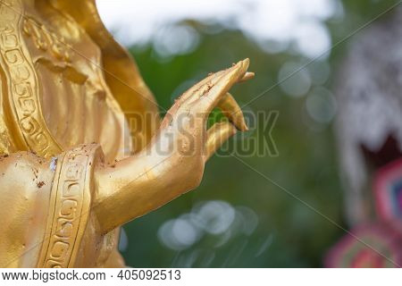 Statues Of Guan Yin Closed Up Hand With Bokeh Is Background