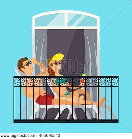 Man And Woman Married Couple Sunbathe On The Balcony Relaxing At Home In The Sun In Bathing Suits. E